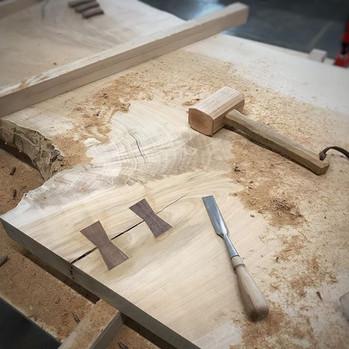 Walnut Bowtie keys in maple desk top