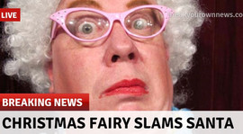 Richard Butler as Lulu, The Evil Christmas Fairy, in a fake promotional news report.