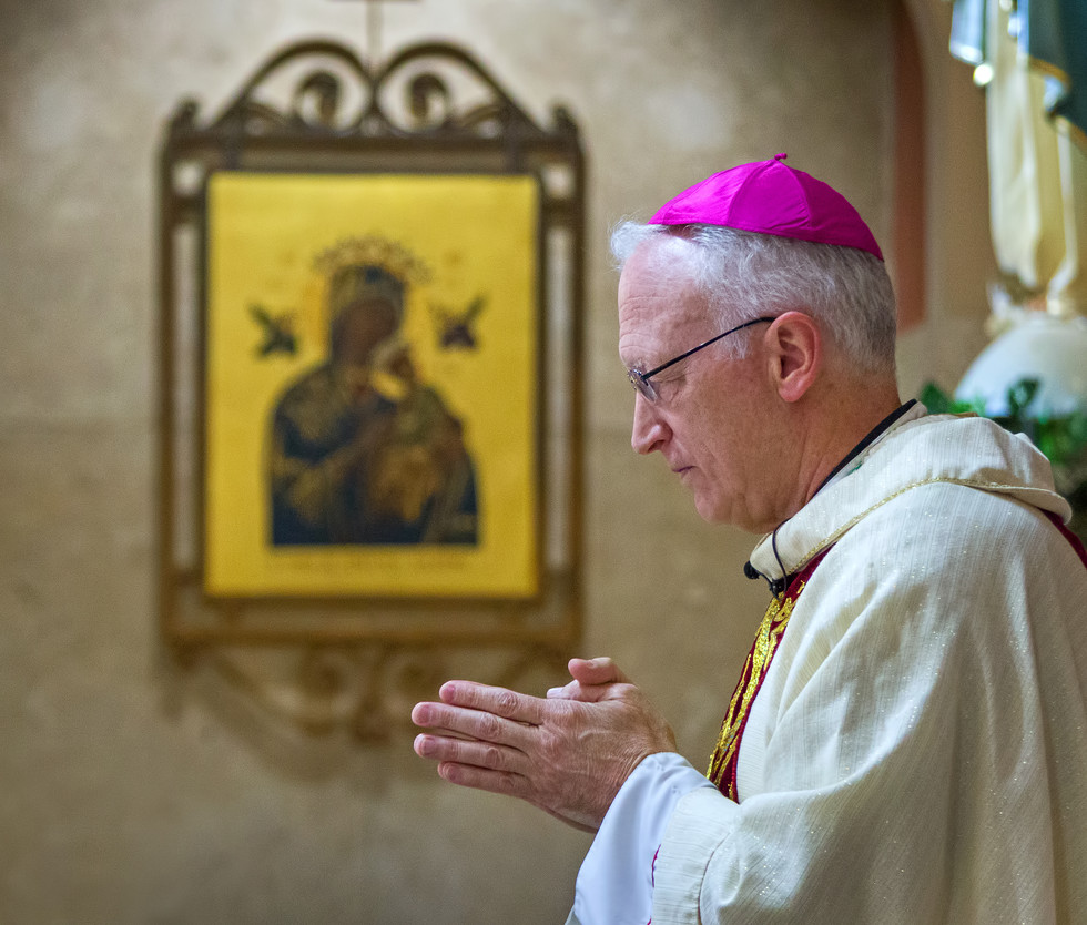 Bishop Boyea with image of Mary behind