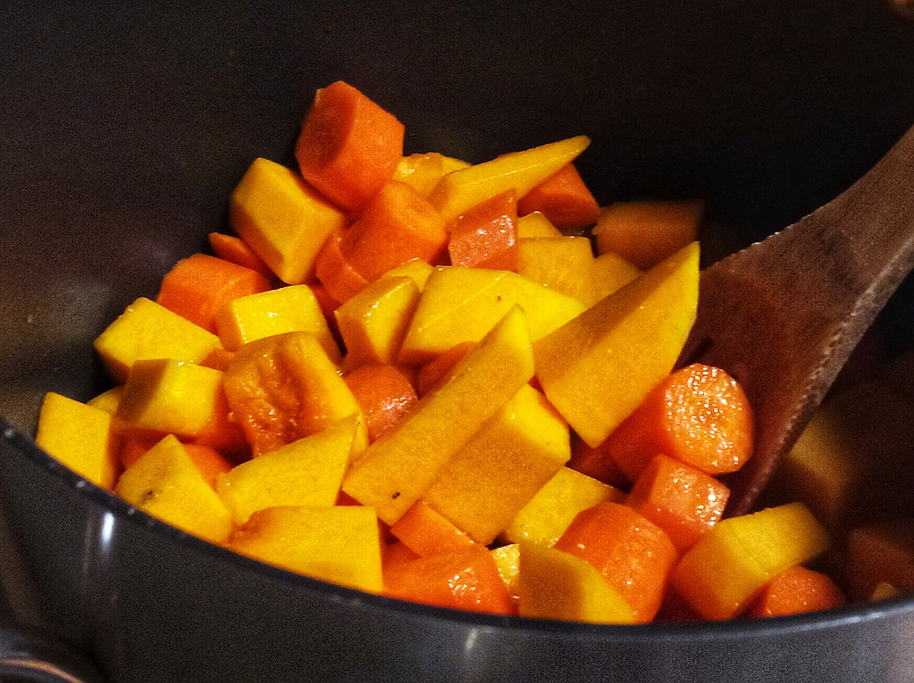 Sear chopped pumpkin and carrots with olive oil