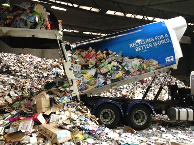 Recycling truck being emptied