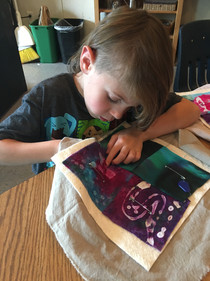 FernLeaf Community Charter School child sewing