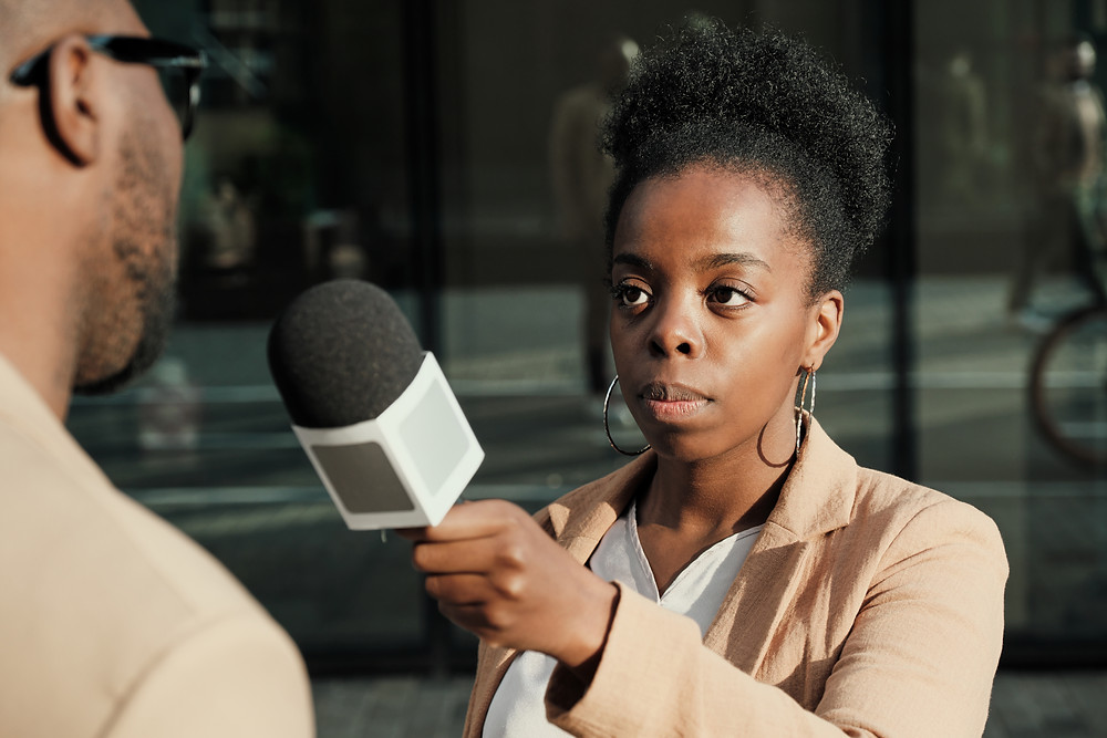 Female Reporter interviewing someone