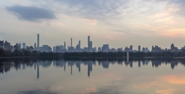 Silhouette of the Manhattan skyline with the reflection in the water