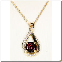 This designer pendant is set with a 6mm Rhodolite garnet with a row of diamond weighing .04 points of diamonds set in 14 karat yellow gold.