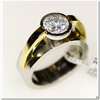 This designer ring is made by Sakamoto. It was created in 18 karat gold and Platinum. This substantial mounting will support a 1.25 carat stone. it currently has a CZ installed for display purposes.