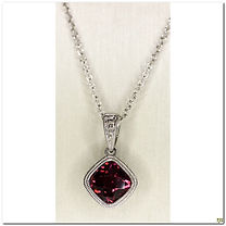 Custom designer, Stanton Color created this 1.15 carat total weight, checkerboard cut rhodolite garnet set in a very detailed milgrain edge, bezel set mounting.