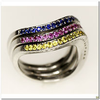 This designer set of three stacker rings in Yellow Pink and Blue sapphires with 1.29 carats in total weight. Created in a stunning wave design.