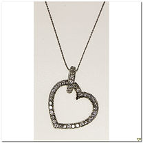 This designer pendant is created by Mastini. It shows off one carat of diamonds both surrounding the heart and the bail. This picture doesn't come close to doing it justice. The heart is 23x22mm large and the bail is fixed in place and will support almost any size chain. Chain sold separately.