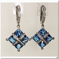 These designer earring are created by Bellarri. They are 18 karat white gold with 6.5 carats of blue topag and .30 carat total weight of diamonds
