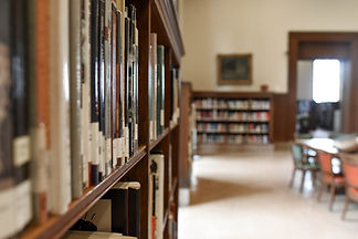 selective-focus-photography-of-bookshelf