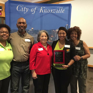 B&B accepting award from City of Knoxville with Mayor Madeline Rogero for Minority Business of the Year