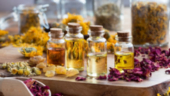 bottles-of-essential-oil-with-dried-rose