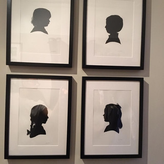 This was a mum's 40th birthday present - silhouette portraits of their four children, hung together in their sitting room