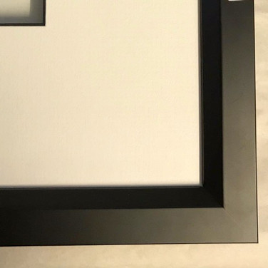 A black frame with a thick bevelled edge