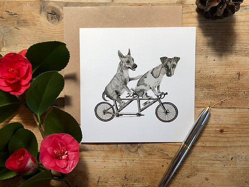 Dogs on a bike greeting card