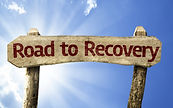 Road to Recovery wooden sign on a summer
