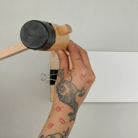 use mallet and an awl to punch holes into the paper