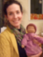 A pleased parent after a doll making workshop