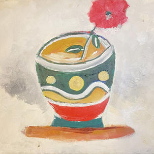 Pink flower in a coffee cup
