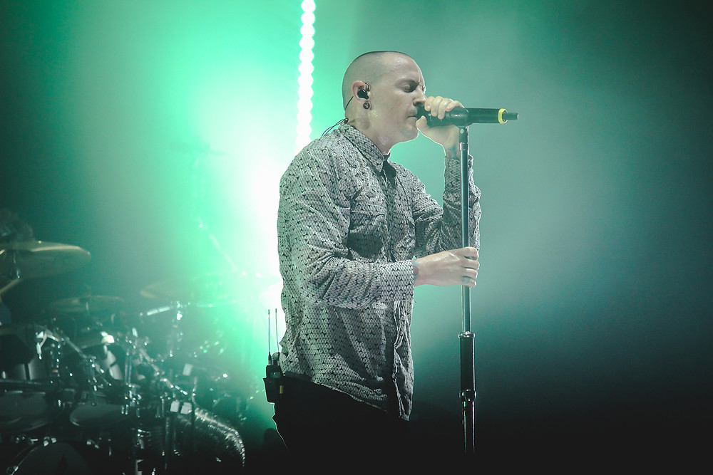 Male Singer at Concert with Wireless Microphone & IEMs