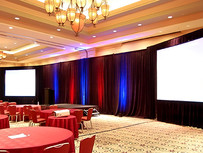 How Drape and Uplighting Can Transform a Room