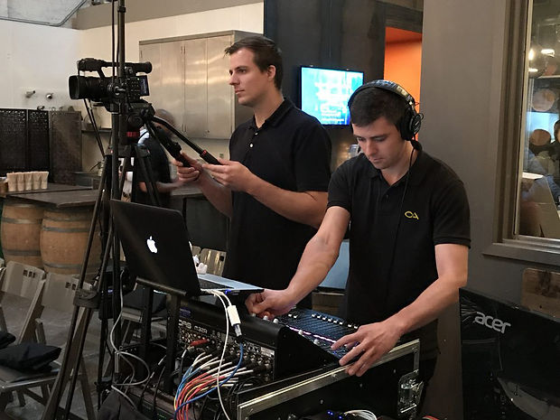 Audio Engineer Mixing Music at Concert