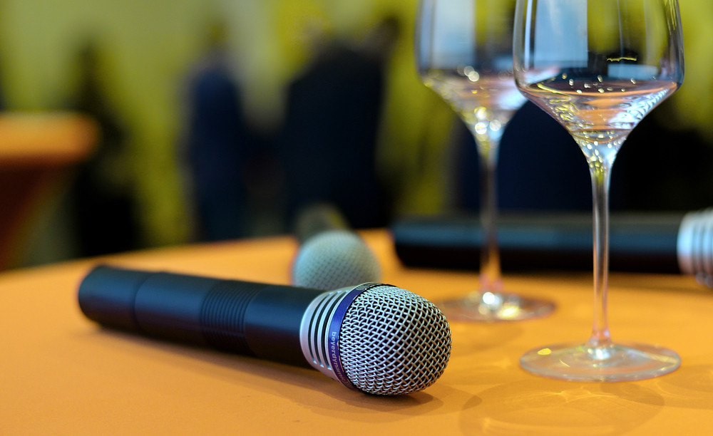Wireless handheld microphone at corporate conference event.