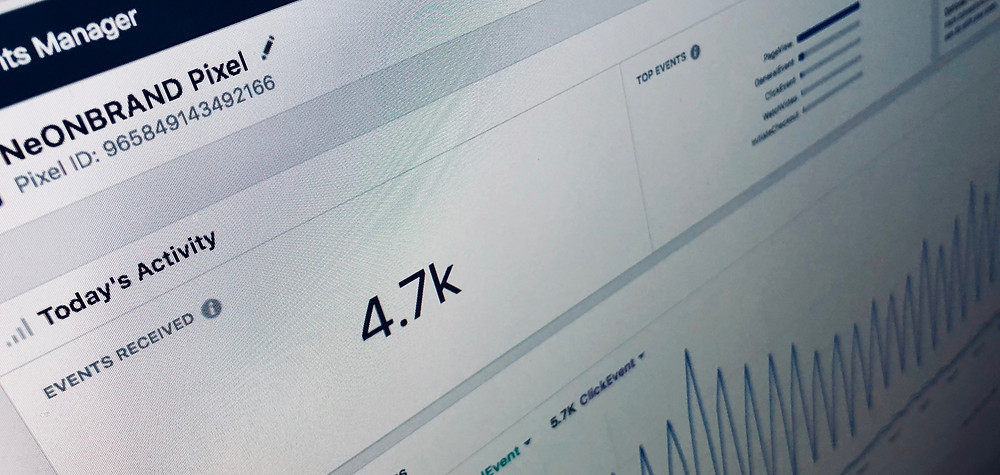 Computer Screen Displaying Facebook Ad Analytics for Event