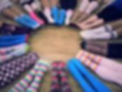 Circle of dancers toes