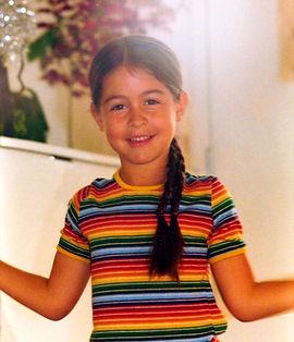 Zoey in Rainbow Shirt.jpg