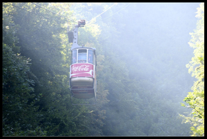 Cable car in Brasov, Romania with Coca-Cola ads