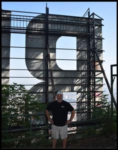 Friend Jim Scott behind Brasov sign in Brasov, Romania