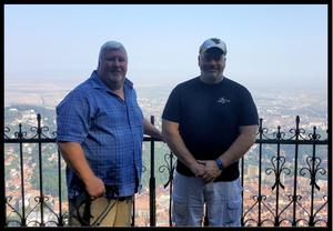 Friends, Terry Hall + Jim Scott on observation deck of Brasov sign in Brasov, Romania