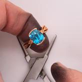 Blue as Santa's eyes, its the elves favorite ring!