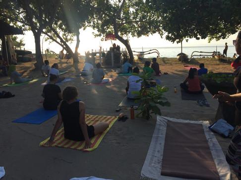 Sunrise yoga class, Bali beach