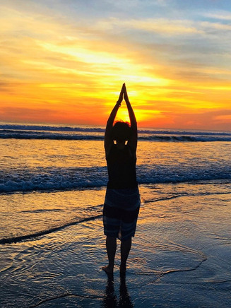 Yoga pose at sunset, Bali