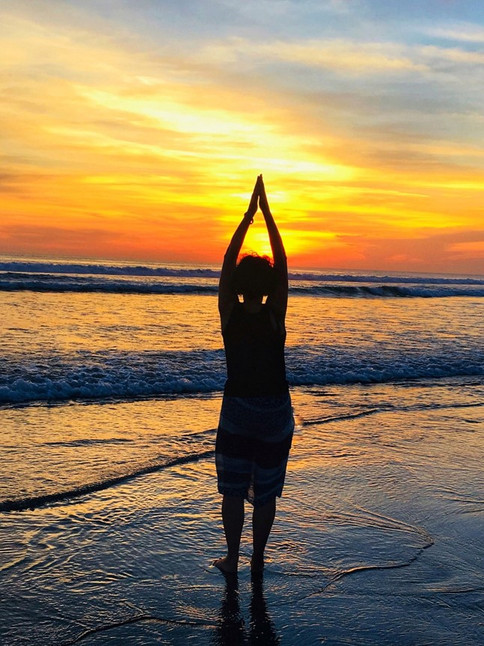 Yoga pose at sunset, Bali