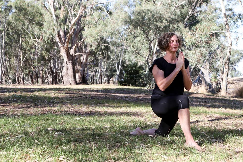 Yoga pose by riverbank