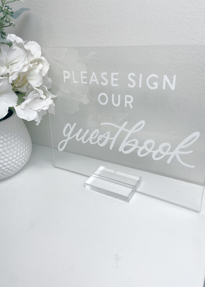 please sign our guestbook sign Clear Acrylic Sign Wooden paper tented Place Cards Clear Acrylic Sign Unplugged Ceremony Signature Drink Illustration Bar Menu Clear Acrylic Sign Seating Chart Calligraphy Wedding Welcome Sign Wedding GTA Toronto York Region Calligraphy Calligrapher Megan Nicole Lettering Order of Events Sign