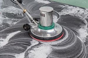 Thai people cleaning black granite floor with machine and chemical.jpg