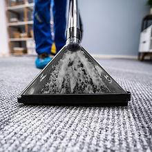 vacuum-cleaner-on-carpet-picture-id1191080458.jpg