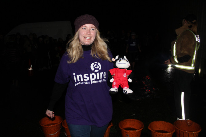 Angus walks on fire for Inspire
