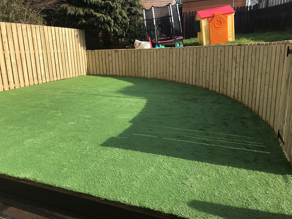 New fence with artificial grass