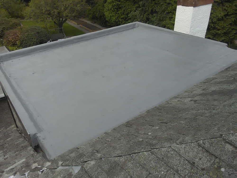 flat roof coated with liquid rubber in Paisley