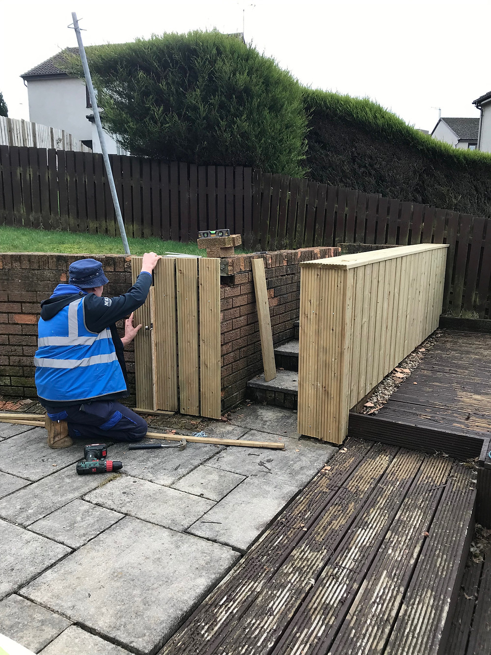 Decking wall cladding being fitted