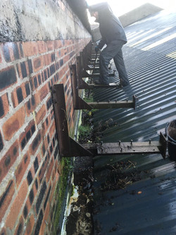 Blocked Gutters Being Cleaned