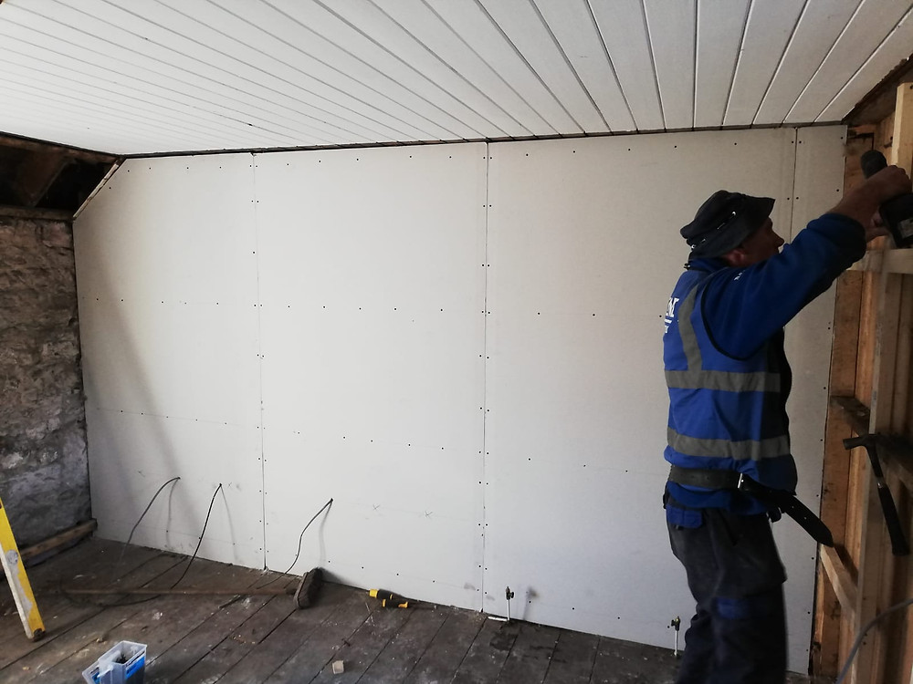 Room being framed out and sheeted out with plasterboard