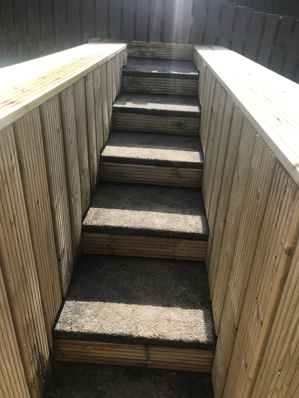 Staircase and steps clad with decking boards