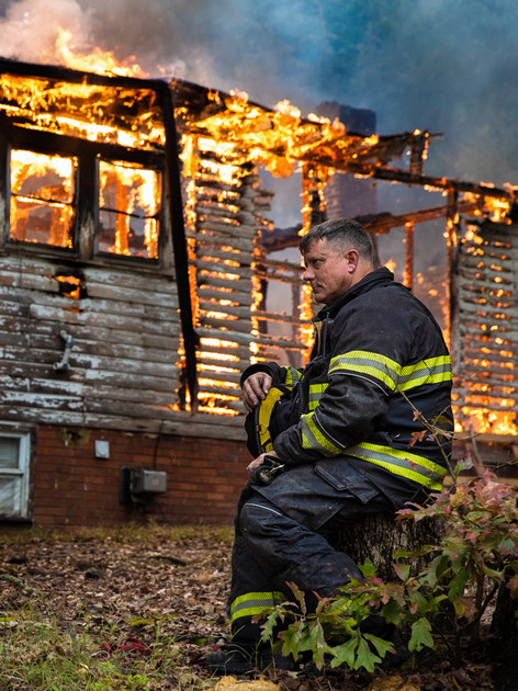 A member of the Asheboro Fire Department monitors a controlled burn of a house located on Telephone Ave in Asheboro on Monday, November 5, 2018. (Photo by Nathan Burton)